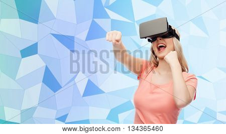 3d technology, virtual reality, entertainment and people concept - happy young woman with virtual reality headset or 3d glasses playing game and fighting blue low poly texture background