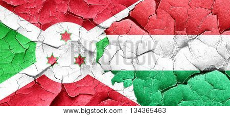 Burundi flag with Hungary flag on a grunge cracked wall