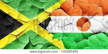 Jamaica flag with Niger flag on a grunge cracked wall