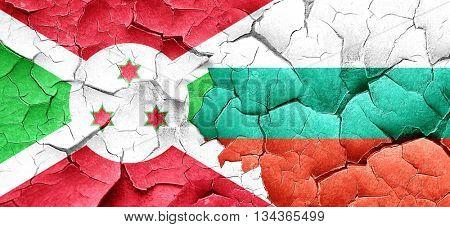 Burundi flag with Bulgaria flag on a grunge cracked wall