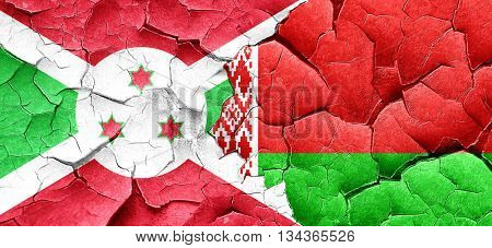 Burundi flag with Belarus flag on a grunge cracked wall