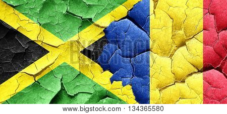 Jamaica flag with Romania flag on a grunge cracked wall