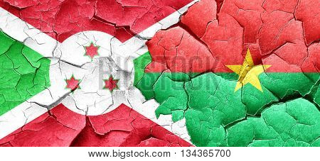 Burundi flag with Burkina Faso flag on a grunge cracked wall