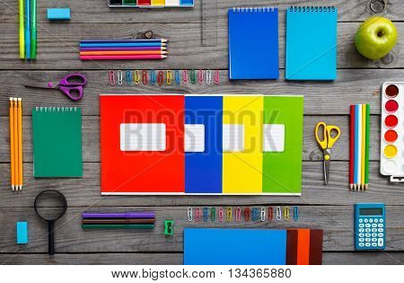 School supplies on wooden table. Flat lay top view