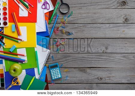 School supplies on a wooden background with copy space top view