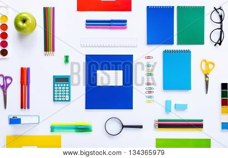 School supplies on a white background. Flat lay top view