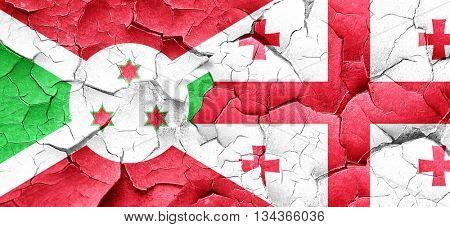 Burundi flag with Georgia flag on a grunge cracked wall