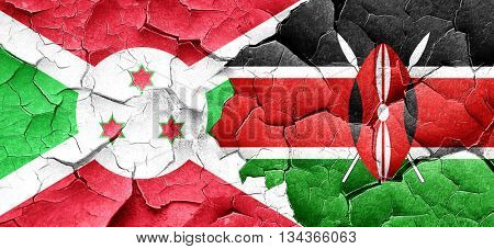 Burundi flag with Kenya flag on a grunge cracked wall