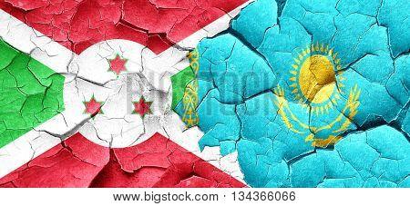 Burundi flag with Kazakhstan flag on a grunge cracked wall