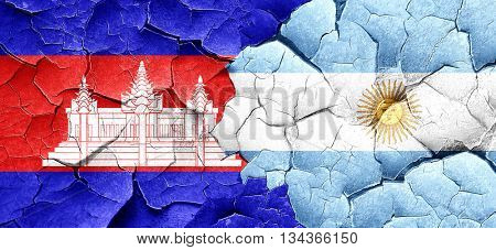 Cambodia flag with Argentine flag on a grunge cracked wall