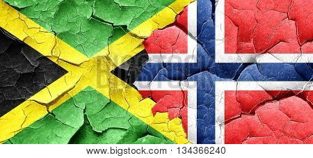 Jamaica flag with Norway flag on a grunge cracked wall
