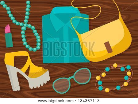 Colored fashion accessories composition with clothing and accessories on the wooden table vector illustration