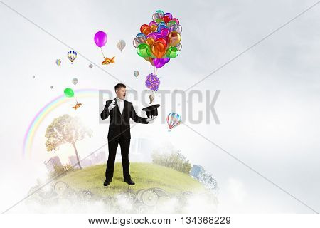 Man magician with cylinder hat