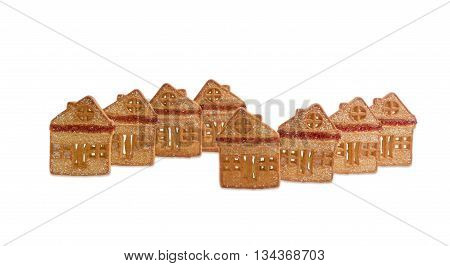 Cookies in the form of houses chalets with inserts of red gelatin on light background