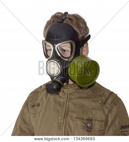 Man in a rubber gas mask with filter mounted on side of the mask and drinking tube on a light background
