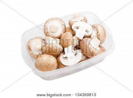 Fresh uncooked button mushrooms in a transparent plastic tray on a light background