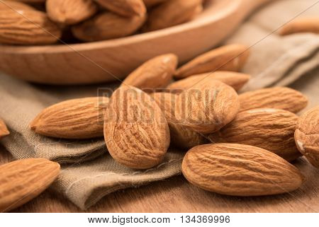 Healthy snack whole almond nut kernels. Close up