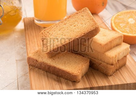 wheat rusk in a wooden panel with jam