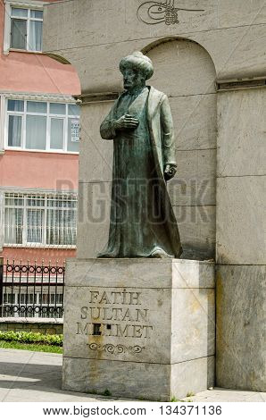 ISTANBUL TURKEY - JUNE 5 2016: Monument to Fatih Sultan Mehmet also known as Mehmed the Conqueror in the Edirnekapi district of Istanbul. Public monument viewed from pavement.