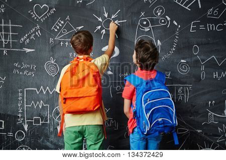 Two schoolboys studying at lesson
