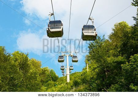 Cableway in the mountains against the sky