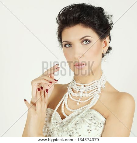 Stylish woman with black hair in evening gown