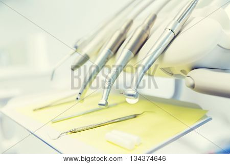 dentistry, medicine, medical equipment and stomatology concept - close up of dental instruments