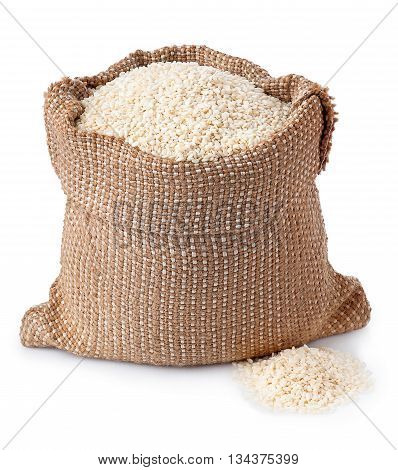 sesame seeds in burlap sack isolated on white background. Full burlap bag with sesame seeds. Sesame seeds