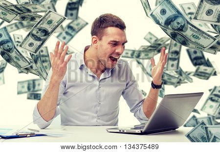 business, people, stress, fail and technology concept - angry businessman with laptop computer and papers shouting over falling money background