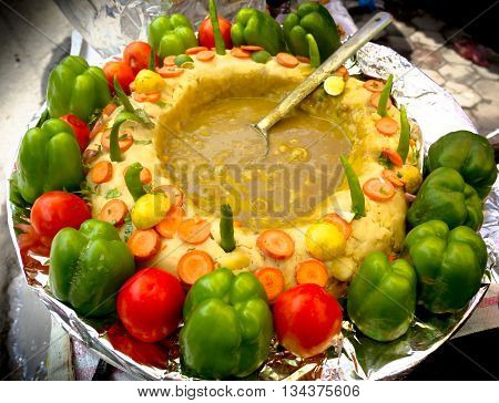 Indian style hot food with decoration on sell in the street of Nepal.