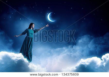 Woman in night sky