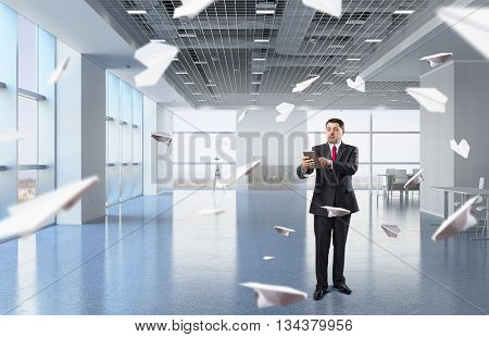 Businessman with tablet in hand