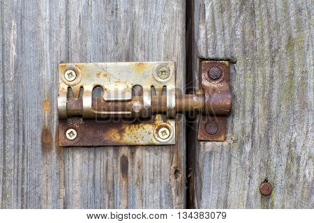 Steel lock of iron corroded by rust. Very old. Strong influence of water. Much time was on the outdoor.
