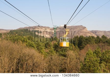 Kislovodsk, Russia - 28 February, Cabin cable car over the forest, 28 February, 2016. Resort zone Mineral Waters, Krasnodar region. Ropeway between the peaks above the forest.