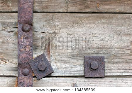 Steel element of iron corroded by rust. Very old. Strong influence of water. Much time was on the outdoor.