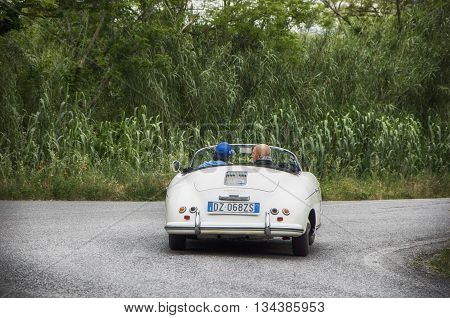 ITALY MILLE MIGLIA 2015  PESARO, ITALY - MAY 15: PORSCHE 356 1500 Speedster 195 on an old racing car in rally Mille Miglia 2015 the famous italian historical race (1927-1957) on May 2015