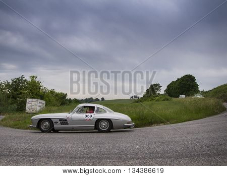 ITALY MILLE MIGLIA 2015 PESARO, ITALY - MAY 15:  on an  MERCEDES-BENZ 300 SL Coupé W 198 1955  old racing car in rally Mille Miglia 2015 the famous italian historical race (1927-1957) on May 2015