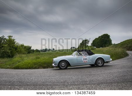 ITALY MILLE MIGLIA 2015 PESARO, ITALY - MAY 15:  on an LANCIA Aurelia B24 spider