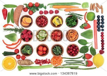 Health and super food selection for paleo diet with fruit and vegetables over white background. High in vitamins, antioxidants, minerals and anthocyanins.