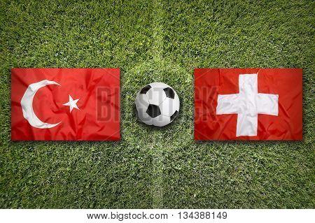 Turkey Vs. Switzerland Flags On Soccer Field