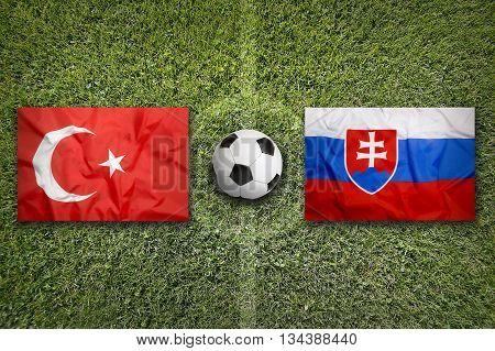 Turkey Vs. Slovakia Flags On Soccer Field