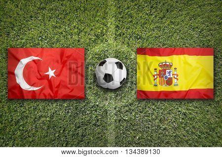 Turkey Vs. Spain Flags On Soccer Field