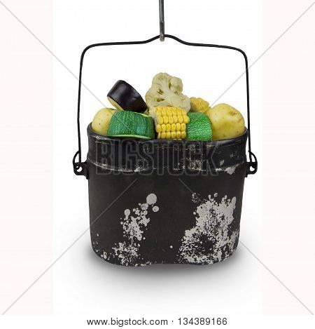 pot with food isolated on white background. Cooking in sooty cauldron on campfire. Organic products. Camping food