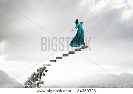 Woman in cloudy sky