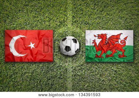 Turkey Vs. Wales Flags On Soccer Field
