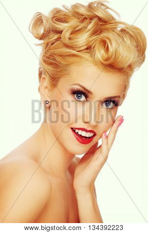 Vintage style portrait of young beautiful sexy blonde pin-up girl with shocked expression