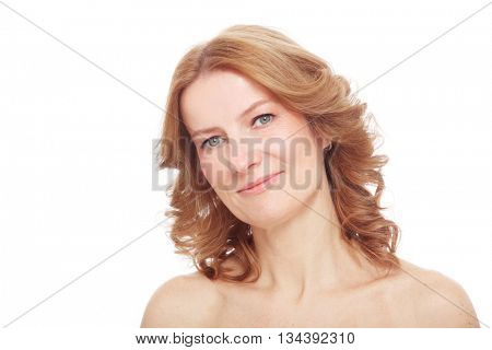 Portrait of beautiful healthy happy smiling mature woman with curly hair and clean make-up, over white background