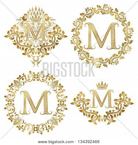 Golden letter M vintage monograms set. Heraldic monogram in coats of arms form letter M in floral round frame letter M in wreath heraldic monogram in floral decoration with crown.