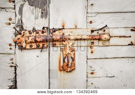 Close up of rusted keyhole on white wooden door (keyhole, rusted, door)