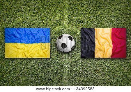 Ukraine Vs. Belgium Flags On Soccer Field